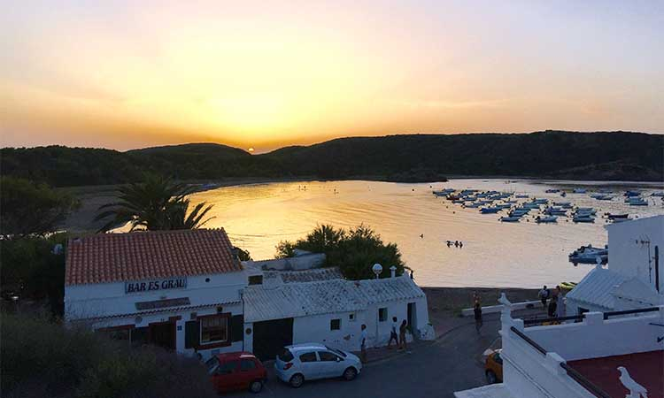 sunset over Es Grau village bar